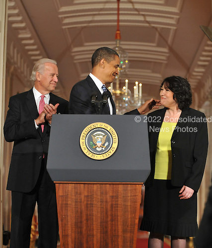 Washington, D.C. - May 26, 2009 -- United States Vice President Joseph Biden, left, applauds as U.S. President Barack Obama, center, congratulates Judge Sonia Sotomayor of the Federal Appeals Court after naming her as his nominee for Justice of the U.S. Supreme Court  in the East Room of the White House on Tuesday, May 26, 2009.  She will replace retiring Justice David Souter. Judge Sotomayor, 54, of The Bronx, New York, will be the first Hispanic to serve if her nomination is approved by the U.S. Senate.  From left to right: Vice President Joseph Biden, President Obama, and Judge Sotomayor..Credit: Ron Sachs / Pool via CNP