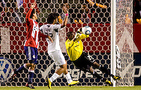 Goalkeeper Sean Johnson of the Chicago Fire dives to his right completing a save. The Chicago Fire defeated CD Chivas USA 3-1 at Home Depot Center stadium in Carson, California on Saturday October 23, 2010.