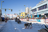 Rick Casillo and team leave the ceremonial start line with an Iditarider and handler at 4th Avenue and D street in downtown Anchorage, Alaska on Saturday March 4th during the 2017 Iditarod race. Photo © 2017 by Brendan Smith/SchultzPhoto.com.
