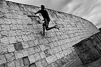 A Colombian parkour runner jumps on the wall during a free running training session of Tamashikaze team in a park in Kennedy, Bogotá, Colombia, 21 February 2016. Parkour, originally developed in France during the late 1980s from military training, is a physical activity, focused on the art of movement and overcoming obstacles in a strictly urban environment. Practitioners of parkour employ running, climbing, jumping, rolling and other movements to pass through any urban area the most efficient way possible.
