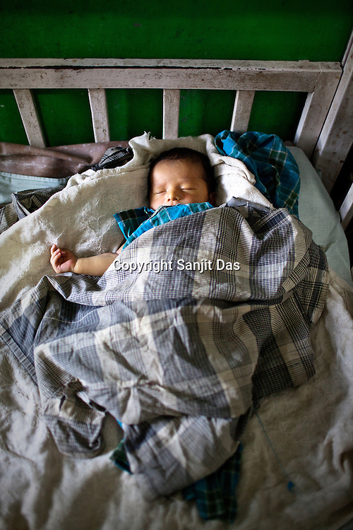 An infant seen in the pediatrics ward of Duncan Hospital in Raxaul of East Champaran district of Bihar, India. Since 2008 the Foundation and Geneva Global have been investing in the training of medical staff to improve the lives of people living in 600+ villages in the region. The NGOs are delivering cost effective interventions to address treatment, care and prevention of diseases, disability and preventable deaths amongst infants, adolescent girls and women of child-bearing age. There is statistical and anecdotal evidence that there have been vast improvements and a total of 40-50% increased immunization for all children under 6 has meant that communities can be serviced and educated long term. Photograph: Sanjit Das/Panos for Legatum Foundation