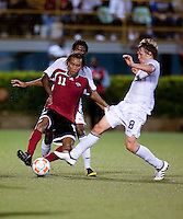 Jared Jeffrey (8) and Trent Lougheed (11) battle for the ball. US Under 20 Men's National Team played to a scoreless draw vs Trinidad & Tobago, advancing after winning 4-3 on penalty kicks at the Marvin Lee Stadium in Macoya, Trinidad on March 13th, 2009 during the 2009 CONCACAF U-20 Championship.