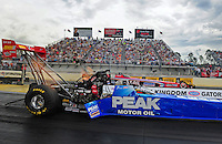 Mar. 9, 2012; Gainesville, FL, USA; NHRA top fuel dragster driver T.J. Zizzo (near lane) races alongside Chris Karamesines during qualifying for the Gatornationals at Auto Plus Raceway at Gainesville. Mandatory Credit: Mark J. Rebilas-