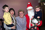 Jonathon and Monica Reid, Nora Guildea and Hannah Doggett with Santa in St. Brigid's Girls School..Picture Paul Mohan Newsfile