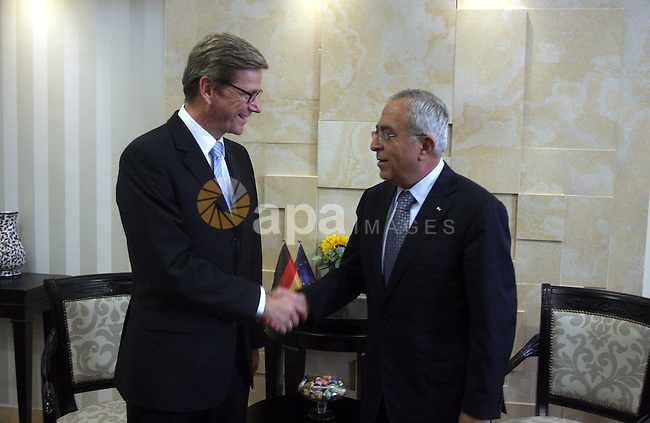 """Palestinian Prime Minister Salam Fayyad (R) shakes hands with Germany's Foreign Minister Guido Westerwelle during their meeting in the West Bank city of Ramallah September 9, 2012. Westerwelle urged Iran on Sunday to bring """"substantial offers"""" to any further nuclear negotiations with world powers and assured Israel that atomic weapons in Tehran's hands was not an option. Photo by Issam Rimawi"""