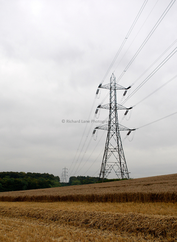 Photo: Richard Lane/Richard Lane Photography. Grain harvest near Little Missenden, Buckinghamshire. Power lines and pylons. 16/09/2008.