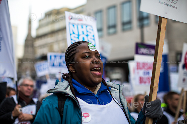 London, 09/01/2016. Today, about 5,000 people, including doctors, student nurses, midwives, junior doctors and other healthcare professionals marched from the Saint Thomas Hospital to Downing Street to protest against the Conservative Government's plan to scrap bursaries for nursing and midwifery students from 2017. The demonstration was organised by the King's College London students and supported by trade unions and other organizations fighting against the plan to privatise the NHS (National Health Service).<br />