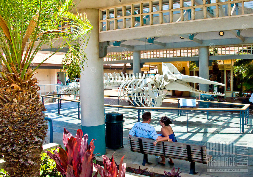 A couple relax at Whaler's Village Shopping Center at Kaanapali