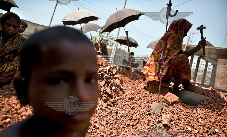 Children work breaking up brick and stone into ballast to be used in concrete. Many children are employed in this work, earning between 25-50 Euro cents a day.