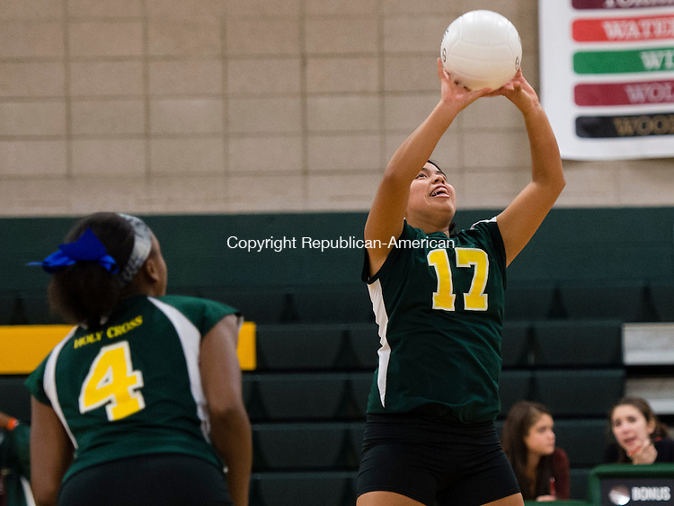 WATERBURY, CT- 27 October 2015-102715EC04-  Holy Cross' Gabrielle Goldman helps the ball over the net in front of Meah Austin. The Crusaders swept the matches against Housatonic Tuesday night. Erin Covey Republican-American