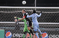 D.C. United defender Daniel Woolard (21) head the ball against Sporting Kansas City forward Kei Kamara (23) Sporting Kansas City defeated D.C. United  1-0 at RFK Stadium, Saturday March 10, 2012.