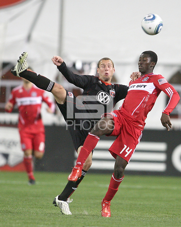 Kurt Morsink #6 of D.C. United kicks the ball over Patrick Nyarko #14 of the Chicago Fire during an MLS match on April 17 2010, at RFK Stadium in Washington D.C. Fire won the match 2-0.