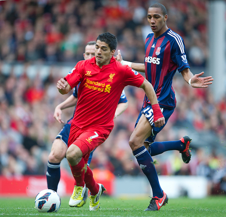 Liverpool's Luis Suarez out paces Stoke City's Charlie Adam and Steven N'Zonzi ..Football - Barclays Premiership - Liverpool v Stoke City - Sunday 7th October 2012 - Anfield - Liverpool..