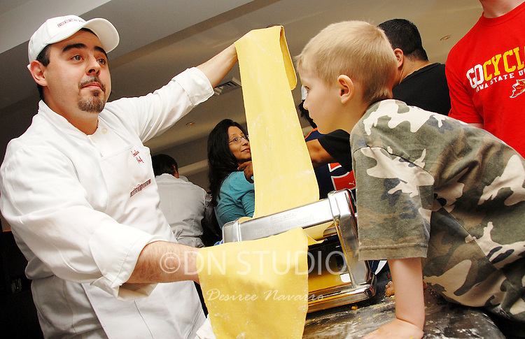 "(L) Chef Paolo Nozzoli. Ciaobella Restaurant brings ""The Art of Pasta"" to Children In Need. Owner and Chef Enrico Proietti and Executive Chef Floess show the children of the Ronald  McDonald House of NY the history of Italian food."