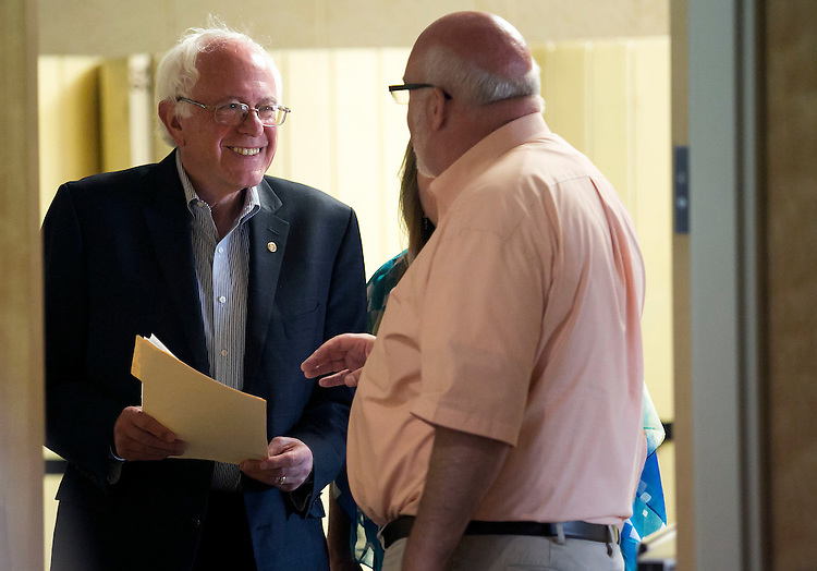 "UNITED STATES - August 16: Sen. Bernie Sanders, D-Vt., laughs as he speaks with a staff member before he speaks at the Loras College Athletic and Wellness Center in Dubuque, Iowa, on Sunday, August 16, 2015. The ""town meeting,"" was the fourth campaign event of the day for Sanders. (Photo By Al Drago/CQ Roll Call)"
