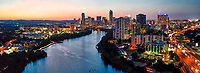 Austin Downtown Night Pano -   Another  Austin Downtown Night pano taken from a birds eye view. This is an aerial image of the Austin skyline at twilight looking down Lady Bird Lake with the city high rise buildings along the shoreline of the lake in the downtown area and also looking north over IH35 where you can see the UT stadium and Erwin Center in the distant view.  You can see Austin tallest building the Austonian which for a few months longer will hold that title till the Independent is completed sometime before the end of the year.  It has been hard to capture images of Austin skyline from anywhere along the hike and bike trail because they are constantly adding new building along the shoreline. About the time you think they are done new cranes show up.  Just recently we found out that we will have two new buildings along the town lake shoreline once more and they will be taller than the Independent so its title will not last long.
