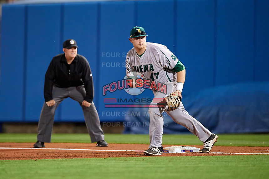 Siena Saints first baseman Joe Drpich (47) gets in position as umpire Chris Tipton looks on during a game against the Florida Gators on February 16, 2018 at Alfred A. McKethan Stadium in Gainesville, Florida.  Florida defeated Siena 7-1.  (Mike Janes/Four Seam Images)