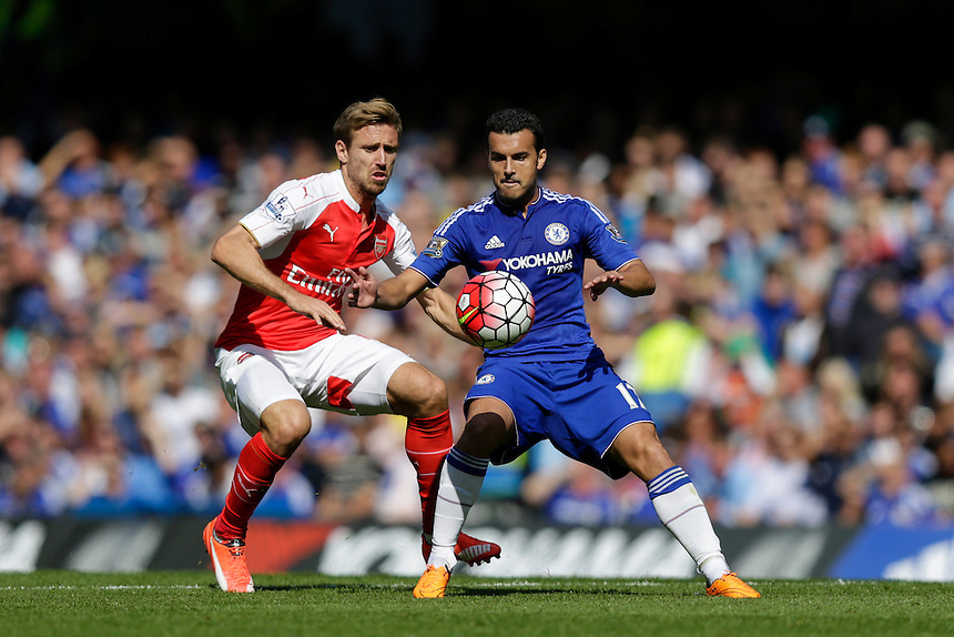 Chelsea's Pedro shields the ball from Arsenal's Nacho Monreal<br /> <br /> Photographer Craig Mercer/CameraSport<br /> <br /> Football - Barclays Premiership - Chelsea v Arsenal - Saturday 19th September 2015 - Stamford Bridge - London<br /> <br /> &copy; CameraSport - 43 Linden Ave. Countesthorpe. Leicester. England. LE8 5PG - Tel: +44 (0) 116 277 4147 - admin@camerasport.com - www.camerasport.com
