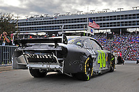 Nov. 8, 2009; Fort Worth, TX, USA; NASCAR Sprint Cup Series driver Jimmie Johnson heads back out onto the track after over an hour in the garage following a crash during the Dickies 500 at the Texas Motor Speedway. Mandatory Credit: Mark J. Rebilas-