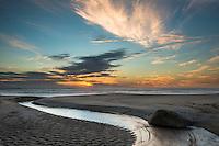 Stream entering Tasman Sea at sunset, Kahurangi National Park, West Coast,  Buller Region, New Zealand, NZ