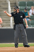 Home plate umpire Shea Gipson makes a strike call during a South Atlantic League game between the Delmarva Shorebirds and the Kannapolis Intimidators at Fieldcrest Cannon Stadium May 14, 2010, in Kannapolis, North Carolina.  Photo by Brian Westerholt / Four Seam Images
