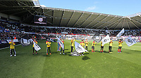 Children form a guard of honours the Barclays Premier League match between Swansea City and Chelsea at the Liberty Stadium, Swansea on April 9th 2016