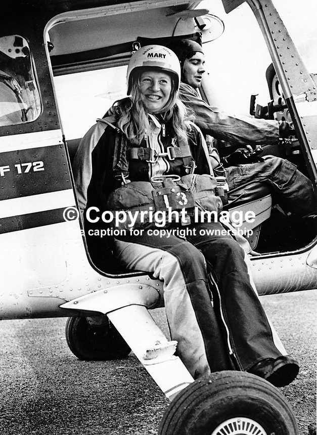 Mary Peters, N Ireland, Gold Medallist, 1972 Munich Olympics women's pentathlon, ready for her first ever parachute jump over Newtownards Airport, Co Down, N Ireland. Obviously not superstitious using parachute number 13. 26th November 1974. 197411260667k<br />