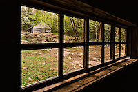 """View of cantilever barn through window of Noah """"Bud"""" Ogle cabin, Roaring Fork Motor Nature Trail, Great Smoky Mountains National Park, Tennessee"""
