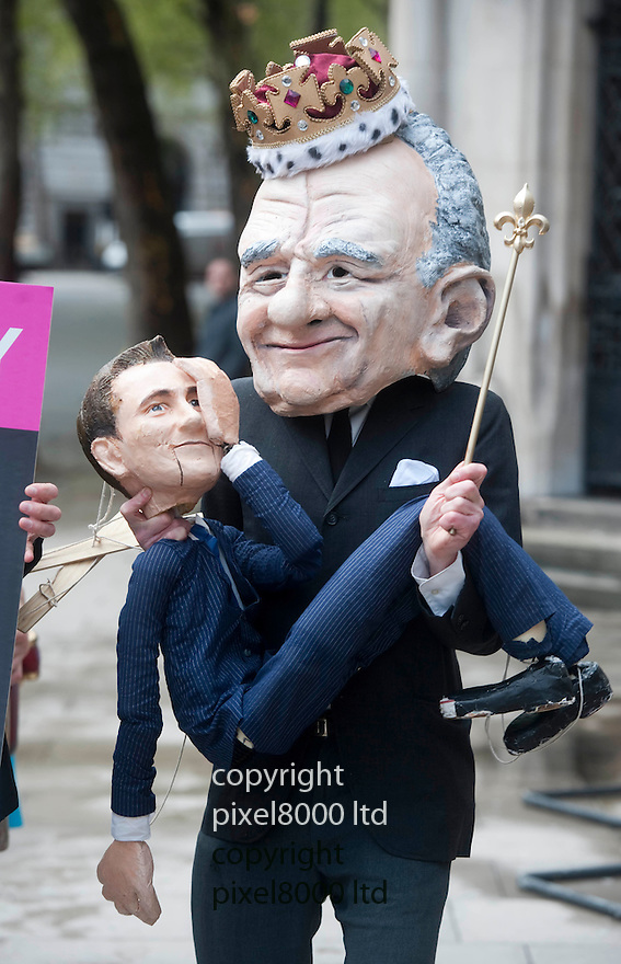 Rupert Murdoch returns for second day at Leveson Inquiry.Rupert Murdoch masked man holding Jeremy Hunt puppet....Pic by Gavin Rodgers/Pixel 8000 Ltd