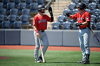 Batavia Muckdogs J.D. Orr (22) high fives Nic Ready (5) after scoring a run during a NY-Penn League game against the West Virginia Black Bears on August 29, 2019 at Monongalia County Ballpark in Morgantown, New York.  West Virginia defeated Batavia 5-4 in ten innings.  (Mike Janes/Four Seam Images)