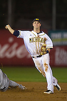 Michigan Wolverines shortstop Derek Dennis #19 turns a double play during a game against the Pittsburgh Panthers at the Big Ten/Big East Challenge at Florida Auto Exchange Stadium on February 17, 2012 in Dunedin, Florida.  (Mike Janes/Four Seam Images)