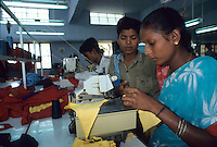 "Asien Indien IND Tamil Nadu Tirupur , .Kinder in einer Textilfabrik n?hen T-shirts f?r den Export fuer westliche Textildiscounter - Industrie Textil Textilien saubere Kleidung Textilbetriebe Globalisierung Arbeit Textilarbeiter  Dritte Welt Billiglohnl?nder WTO ILO xagndaz | .Third world Asia India .children sew T-shirts for export in textile unit at textile industry place T-shirt town Tirupur in Tamil Nadu - textiles globalization trade clothes clean campaign  ccc garments fabric cotton industries labour labourer . | [copyright  (c) Joerg Boethling/agenda , Veroeffentlichung nur gegen Honorar und Belegexemplar an / royalties to: agenda  Rothestr. 66  D-22765 Hamburg  ph. ++49 40 391 907 14  e-mail: boethling@agenda-fototext.de  www.agenda-fototext.de  Bank: Hamburger Sparkasse BLZ 200 505 50 kto. 1281 120 178  IBAN: DE96 2005 0550 1281 1201 78 BIC: ""HASPDEHH""] [#0,26,121#]"