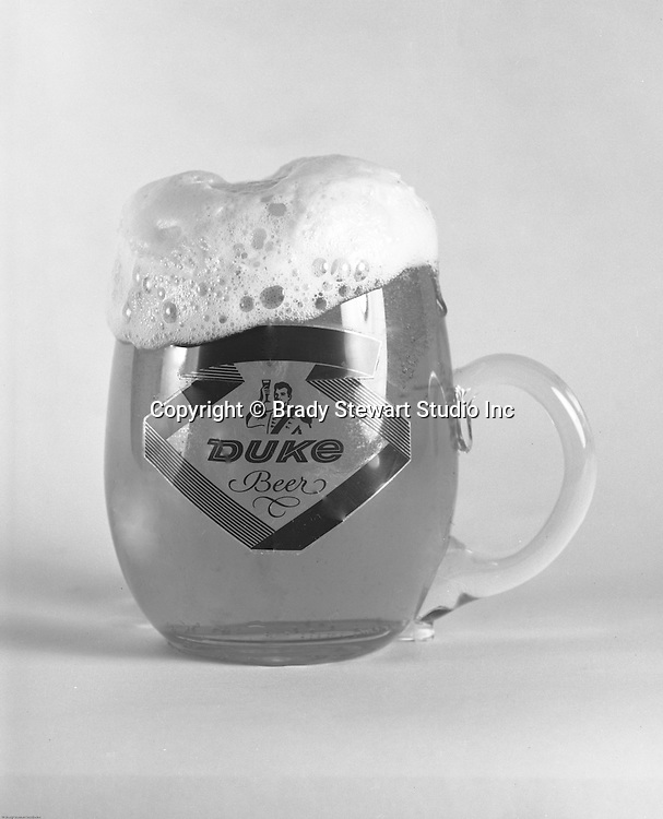 Client: Duquesne Brewing Company<br /> Ad Agency:  Frank Hnat Studio<br /> Contact: Ed Hnat<br /> Product: Duquesne Pilsner<br /> Location: Brady Stewart Studio at 211 Empire Building in Pittsburgh <br /> <br /> Studio Photography of a Glass of Duke Beer.  Photographic assignment for Frank Hnat Studio - Have a Duke Beer - 1970