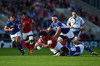 Hale T Pole of Tonga is tackled to ground by Eneill Buitendag of Namibia. Rugby World Cup Pool C match between Tonga and Namibia on September 29, 2015 at Sandy Park in Exeter, England. Photo by: Patrick Khachfe / Onside Images