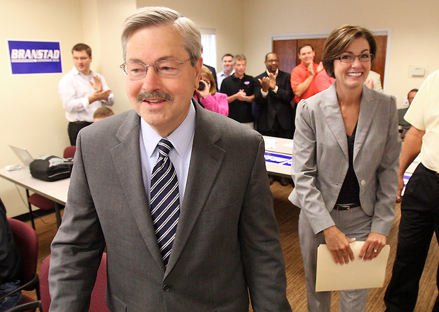 Republican candidate for governor Terry Branstad walks with state Sen. Kim Reynolds of Osceola as he arrives to announce Reynolds as his running mate Thursday, June 24, 2010, in Ankeny.
