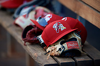 Palm Beach Cardinals hats and gloves sit on the dugout bench during a game against the Charlotte Stone Crabs on April 21, 2018 at Charlotte Sports Park in Port Charlotte, Florida.  Charlotte defeated Palm Beach 5-2.  (Mike Janes/Four Seam Images)