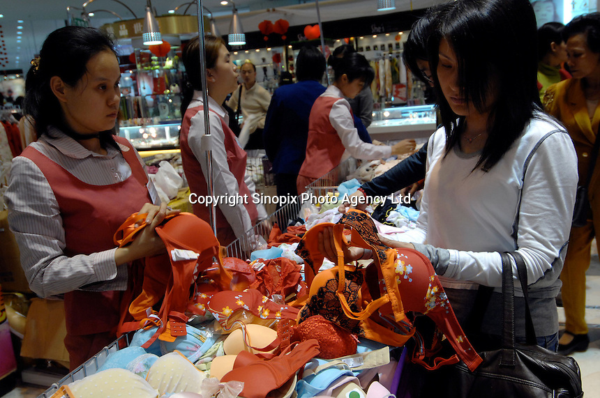 A female shooper browsing lingeries and underwears in a shopping center during Lunar New Year holidays in Guilin, China..03 Mar 2007