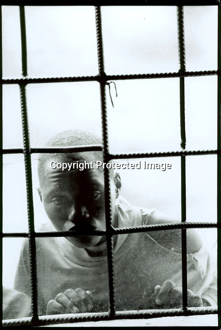 dicorwa00042 .Rwanda. A youth prisoners accused of the genocide in Rwanda in 1994 looking out of a window in the youth prison on April 20, 1995 in Gitagata, Rwanda. About one million people were killed during a civil war in the country. .©Per-Anders Pettersson/iAfrika Photos
