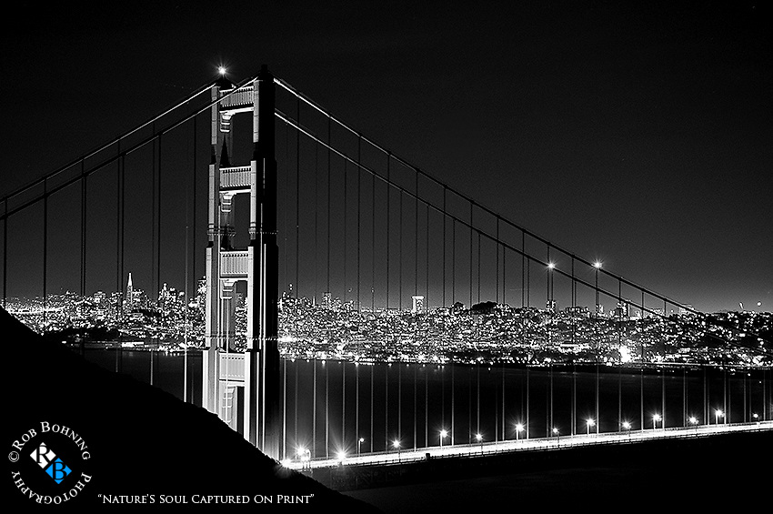 The North tower of the Golden gate bridge and city lights in the background