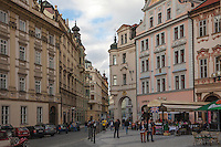 Little Quarter neighborhood is huddled beneath the castle on the left bank of Vltava River