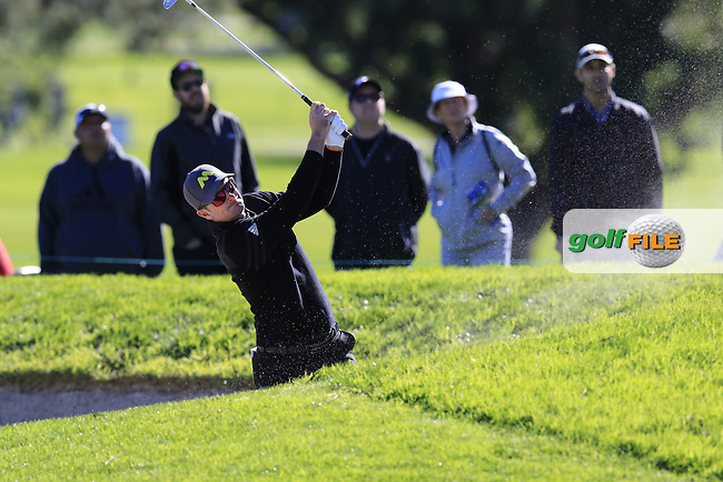 Justin Rose (ENG) plays his 2nd shot from a fairway bunker on the 1st hole during Friday's Round 2 of the 2017 Farmers Insurance Open held at Torrey Pines Golf Course, La Jolla, San Diego, California, USA.<br /> 27th January 2017.<br /> Picture: Eoin Clarke | Golffile<br /> <br /> <br /> All photos usage must carry mandatory copyright credit (&copy; Golffile | Eoin Clarke)