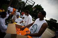 an organizer distributes team T Shirt at a basketball tournament organized by a local pastor in Roseland, Chicago, Illinois, United States on Wednesday August 6 2008..The pastor promotes sports as a way to defeat violence..Senator Barack Obama, the 2008 democratic party presidential candidate, begun his political career by being an organizer in these neighborhoods..Roseland and other South Side neighborhoods of Chicago are among the most violent and segregated in the country.