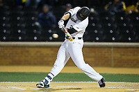 Gavin Sheets (24) of the Wake Forest Demon Deacons makes contact with the baseball during game two of a double-header against the Kent State Golden Flashes at David F. Couch Ballpark on March 4, 2017 in Winston-Salem, North Carolina.  The Demon Deacons defeated the Golden Flashes 5-0.  (Brian Westerholt/Four Seam Images)