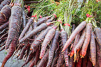 Purple carrots for sale in the Union Square Greenmarket in New York on Wednesday, October 30, 2013.  (© Richard B. Levine)