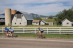 Tandem bike and cyclist, with farm in Boulder, Colorado John offers private photo tours of Boulder, Denver and Rocky Mountain National Park. .  John leads private photo tours in Boulder and throughout Colorado. Year-round.