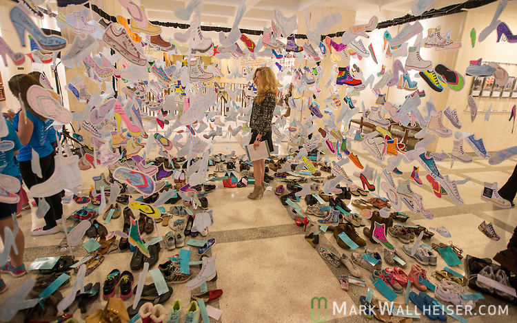 Rep. Kristin Jacobs (D- Coconut Creek)  looks at a display of 1,000 shoes of victims of sexual violence on display at the Florida Capitol in Tallahassee, Florida for Sexual Assault Awareness Month.  The display is hosted by Lauren's Kids and the Florida Council Against Sexual Violence.