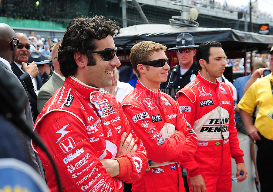 May 24, 2009; Indianapolis, IN, USA; IRL driver Dario Franchitti (left) Ryan Briscoe (center) and Helio Castroneves prior to the 93rd running of the Indianapolis 500 at Indianapolis Motor Speedway.  Mandatory Credit: Mark J. Rebilas-