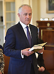 Australian Prime Minister Malcolm Turnbull takes the oath at Government House, Canberra on September 15, 2015. Photographer: Mark Graham/Bloomberg