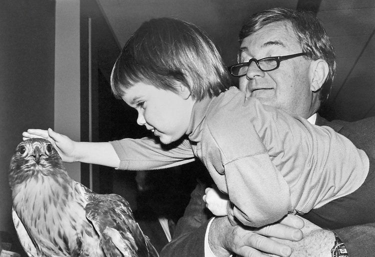 "Rep. Charles Grandison ""Charlie"" Rose III, D-N.C., holds his daughter, Kelly (age 3), while she pets a red eagle at the Ranger Rick Scarlett fox party. January 28, 1991 (Photo by Laura Patterson/CQ Roll Call)"