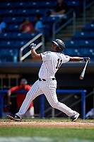 Staten Island Yankees left fielder Canaan Smith (11) follows through on a swing during a game against the Lowell Spinners on August 22, 2018 at Richmond County Bank Ballpark in Staten Island, New York.  Staten Island defeated Lowell 10-4.  (Mike Janes/Four Seam Images)